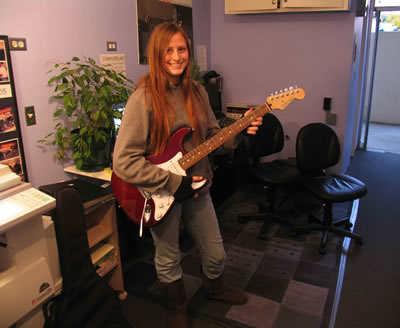 guitar school contest winner audrey and her strat