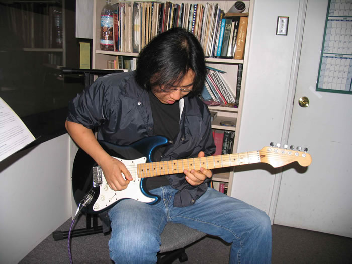 john whang redondo guitar school student in a guitar lesson with instructor mark fitchett